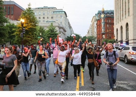 Washington, D.C. - July 07 2016: Protestors march down Pennsylvania Ave from the White House to the Capitol Building after recent police involved shootings of Alton Sterling and Philando Castile