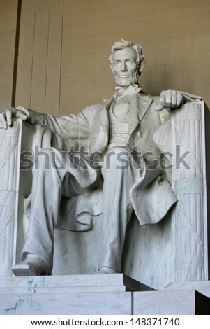 WASHINGTON, D.C. - JULY 29: The statue of Abraham Lincoln is shown at the Lincoln Memorial on July 29, 2013 in Washington, D.C. Vandals recently threw green paint on the statue (seen near right foot). - stock photo
