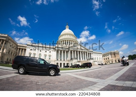WASHINGTON, D.C. - JUNE 11, 2014: Government vehicles parked in front of The Capitol. It is the seat of the United States Congress. - stock photo