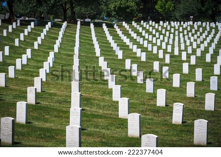 WASHINGTON, D.C. - JUNE 20, 2014: Headstones at Arlington National Cemetery in Washington, D.C. Arlington National Cemetery was established in 1864. - stock photo