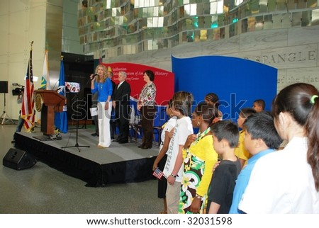 WASHINGTON,D.C. - JUNE 14: Jordan Shelton, Winner of National Anthem Singing Contest, sings National anthem on June 14, 2009 on Flag Day Ceremony at Museum of American History in Washington, D.C. - stock photo