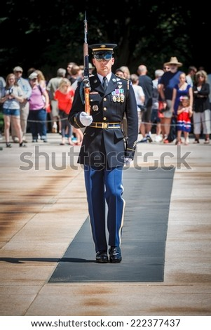 WASHINGTON, D.C. - JUNE 20, 2014: Tomb Guard sentinel at The Tomb of the Unknown Soldier at Arlington National Cemetery. The Tomb is guarded 24 hours a day, 365 days a year, and in any weather.