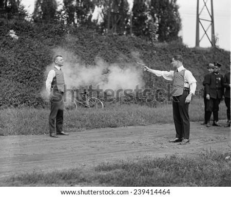 Washington, D.C. law enforcers test a new bullet proof vest in 1923. - stock photo