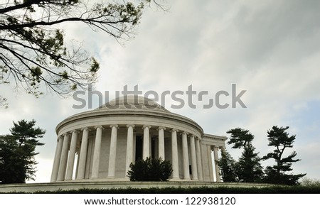 WASHINGTON, D.C. - MARCH 31: The Jefferson Memorial shown during the 2012 Cherry Blossom Festival sits under storm clouds on March 31, 2012 in Washington, D.C. - stock photo