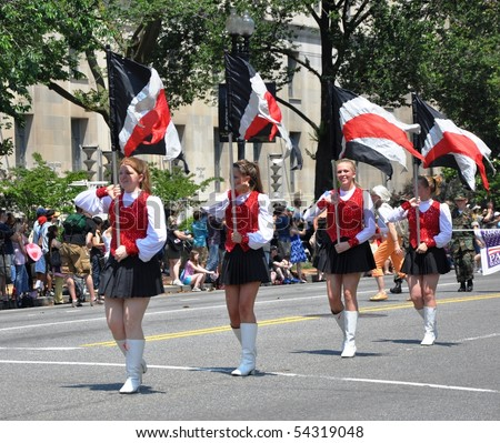WASHINGTON, D.C. - MAY 31: girls with flags of Black Knight Marching Band  May 31, 2010 in the National Memorial Day Parade in Washington, D.C.