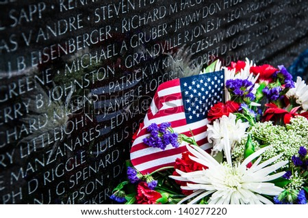 WASHINGTON, D.C. - MAY 27, 2013: People visit and lay flowers at the Vietnam Veterans Memorial on May 27, 2013, in Washington, D.C. - stock photo