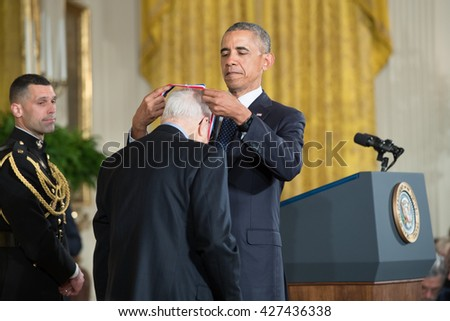 WASHINGTON, D.C. - MAY 19: President Obama awards Dr. Albert Bandura on May 19, 2016 in Washington, D.C. The ceremony recognized the contributions of 17 top scientists, engineers, and inventors. - stock photo