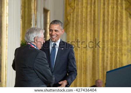 WASHINGTON, D.C. - MAY 19: President Obama awards Dr. Robert Fischell on May 19, 2016 in Washington, D.C. The ceremony recognized the contributions of 17 top scientists, engineers, and inventors. - stock photo