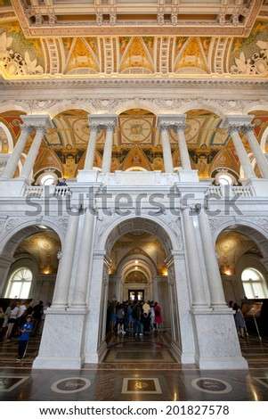 WASHINGTON D.C. - MAY 23 2014: Visitors in the lobby of the Library of Congress in Washington D.C. The Library of Congress is the  largest library in the world. - stock photo