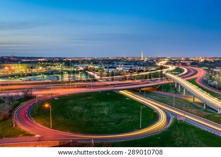 Washington, D.C. skyline with highways and monuments. - stock photo