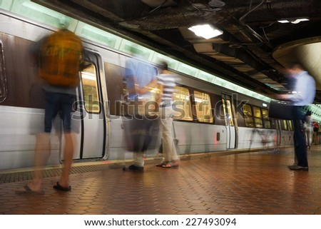 Washington D.C. - Subway station with passengers in motion blur  - stock photo
