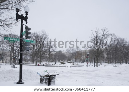 Washington, D.C., USA - January 23, 2016: Snow-covered empty crossroad during a snowstorm.