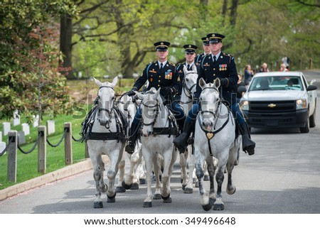 WASHINGTON D.C., USA - MAY, 2 2014 - US Army marine funeral at Arlington cemetery: coffin on the horse coach - stock photo