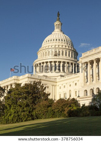 WASHINGTON D.C., USA-OCTOBER 15, 2010:The US Capitol was completed in the year 1800 and  is the seat of the United States Congress. It sits atop Capitol Hill, at the eastern end of the National Mall. - stock photo