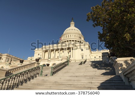 WASHINGTON D.C., USA-OCTOBER 15, 2010:The US Capitol was completed in the year 1800 and  is the seat of the United States Congress. It sits atop Capitol Hill, at the eastern end of the National Mall.