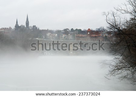 Washington DC - a view from Georgetown and Key bridge in snow blizzard  - stock photo