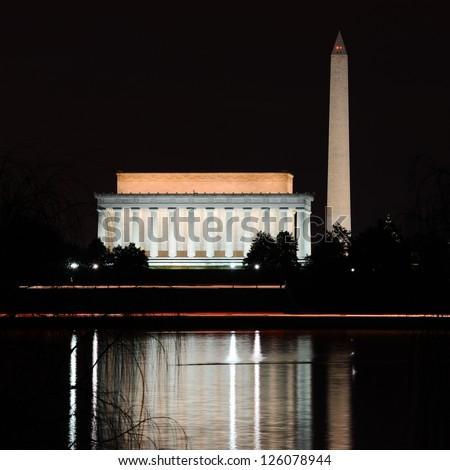 Washington DC - Abraham Lincoln Memorial, Monument and Arlington Bridge on Potomac River at night - stock photo
