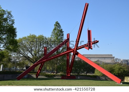 WASHINGTON, DC - APR 16: Are Years What sculpture by Mark di Suvero at the Hirshhorn Sculpture Garden in Washington, DC, on April 16, 2016. In 2013, the Sculpture Garden drew 645,000 visitors. - stock photo