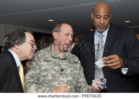WASHINGTON, DC  APRIL 11: Former Major League Baseball Player Tony Clark signs autographs before a luncheon at the National Press Club, April 11, 2012 in Washington, DC - stock photo