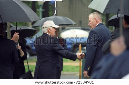WASHINGTON, DC - APRIL 29: Senator Richard Lugar (left) at a ceremony on the grounds of the U.S. Capitol in Washington, DC on April 29, 2005. Lugar, Republican of Indiana, was first elected in 1977. - stock photo