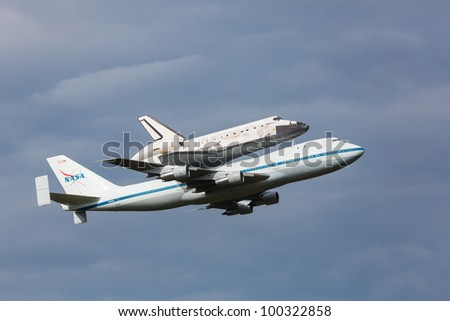 WASHINGTON DC - APRIL 17: Space Shuttle Discovery  on top of Boeing 747 arrives at Dulles Airport in Washington DC on April 17, 2012. Discovery will be a part of permanent display at Air&Space Museum - stock photo