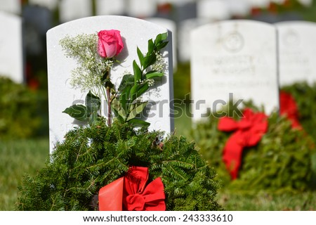 Washington DC - Arlington National Cemetery gravestones with Christmas wreaths - stock photo