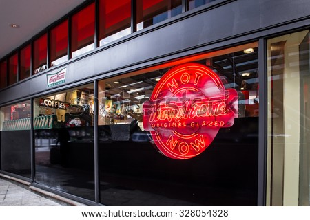 WASHINGTON, DC - AUGUST 8, 2015: View of the Krispy Kreme Doughnut storefront in Washington DC at Dupont Circle.  - stock photo