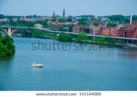 Washington DC by the Potomac river. elevated view of Washington DC by the Potomac river. In the picture are Key bridge, and Georgetown waterfront park and harbor. - stock photo