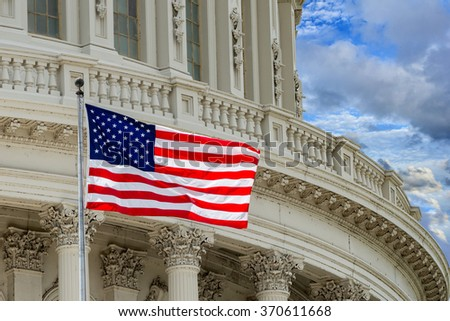 Washington DC Capitol dome detail with waving americanstar and stripes flag - stock photo