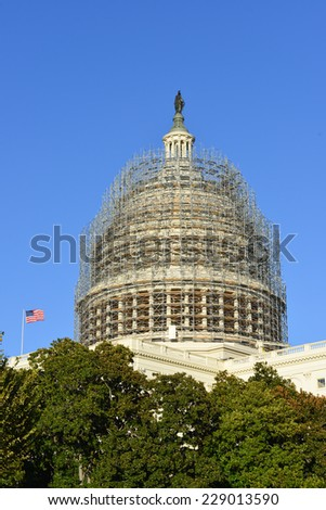 Washington DC - Capitol dome in renovation framed in scaffolding materials - stock photo