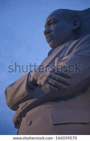 WASHINGTON, DC - CIRCA 2013:The Martin Luther King Jr. Memorial and Washington Monument at dusk with lights on, a monument to civil rights leader. Located in Washington, D.C. on the National Mall on the Tidal Basin.  - stock photo