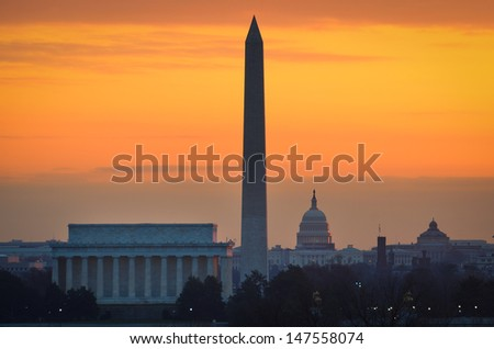 Washington DC city view at a orange sunrise, including Lincoln Memorial, Monument and Capitol building