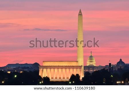 Washington DC city view at a reddish sunrise, including Lincoln Memorial, Monument and Capitol building - stock photo