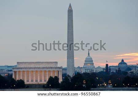 Washington DC city view at sunrise, including Lincoln Memorial, Monument and Capitol building