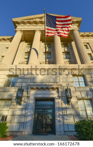 Washington DC, Department of Commerce Building with waving US flag - stock photo