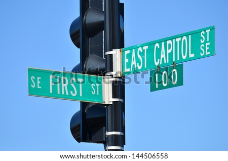 Washington DC - East Capitol Street and First Street junction street sign  - stock photo