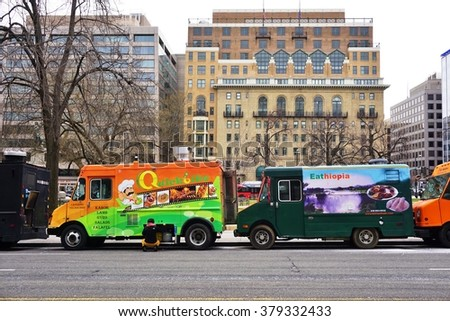 WASHINGTON, DC -19 FEB 2016- A food truck parked on the street in Washington, DC. Food trucks have become very popular in front of office buildings in DC.