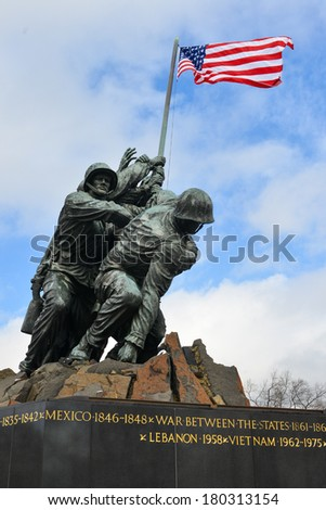WASHINGTON, DC - FEBRUARY 26, 2014: Iwo Jima Memorial in Washington, DC. The Memorial honors the Marines who have died defending the US since 1775 and a prominent tourist attraction in Washington DC.  - stock photo