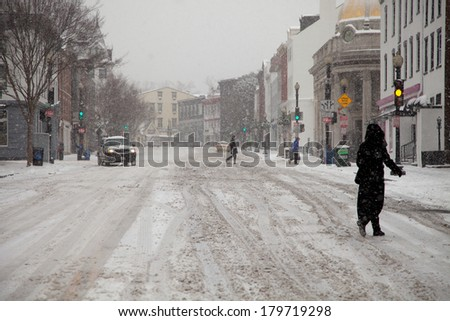 WASHINGTON, DC - FEBRUARY 3: Winter storm of the Mid Atlantic on February 3, 2014 in Washington, DC. Wisconsin Avenue in Georgetown. The government as well as most stores and companies where closed. - stock photo