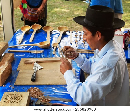 WASHINGTON, DC - JULY 1: A Peruvian man finishes wooden kitchen utensils with carving tools and sandpaper  at the Smithsonian Folklife Festival on July 1, 2015, in Washington, D.C. - stock photo