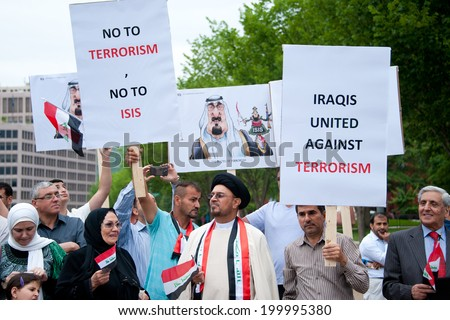 WASHINGTON, DC - JUNE 21: Iraqi demonstrators protested against ISIS in front of the White House in Washington, DC on June 21, 2014. - stock photo