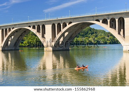 Washington DC,Key Bridge and mirror reflection over Potomac River with kayaking people   - stock photo