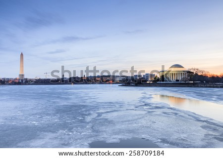 Washington DC landmarks along the frozen Potomac River at the Tidal Basin in Washington, DC at daybreak. - stock photo