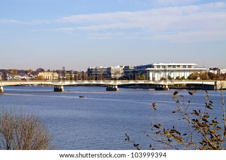 Washington, DC, landscape view, Theodore Roosevelt Bridge over Potomac River and Kennedy Art center in distance - stock photo