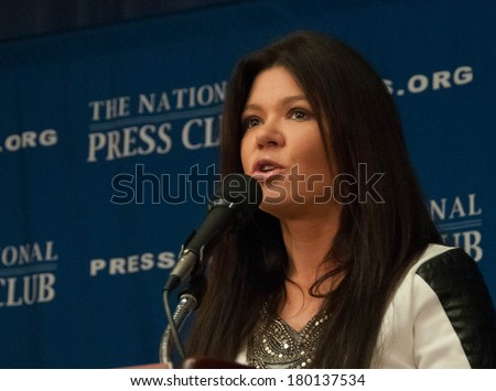 WASHINGTON, DC - MARCH 5, 2014:  Ukrainian pop singer and democracy activist Ruslana Lyzhychko speaks at a press conference at the National Press Club - stock photo