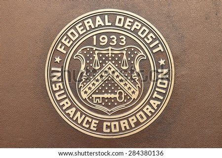 WASHINGTON, DC - MAY 4: Federal Deposit Insurance Corporation plaque in Washington, DC on May 4, 2015. Its mission is to maintain stability and public confidence in the nationâ??s financial system.