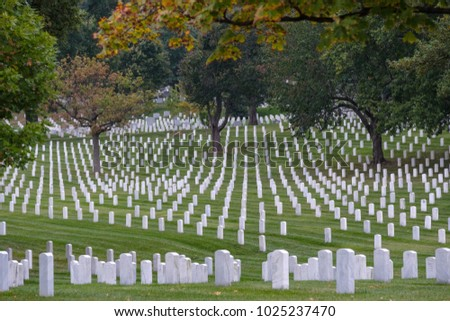 WASHINGTON DC - OCT 11: Rows and columns of US soldier's tombstones at Arlington National Cemetary in Washington DC on October 11, 2011.