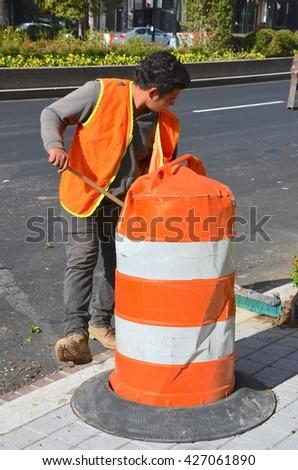 WASHINGTON,DC - OCTOBER 24: Street Utility Workers Dupont Circle on October 24, 2015 in Washington, DC USA. One of the most busy streets in Washington, DC. - stock photo