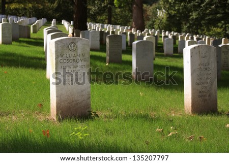WASHINGTON DC - SEP 15: Rows and columns of US soldier's tombstones at Arlington National Cemetary in Washington DC on Sept. 15, 2012.