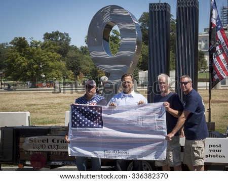 WASHINGTON DC - SEPT 11, 2015: U.S. Congressman Dave Brat (R-Va.) by the 911 Standing Tall Memorial sculpture by SteelCrazy IronArt in front of the U.S. Capitol at 2 Million Bikers to DC honor ride. - stock photo